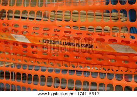 Plastic Orange Safety Net To Delimit The Area Of A Road Construc