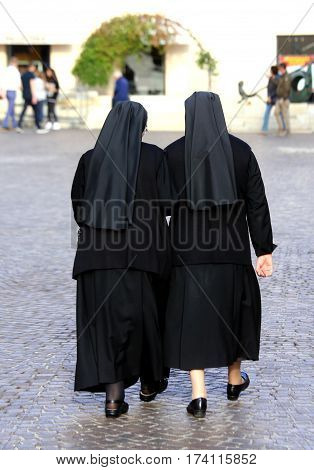 Sisters With Long Blacks Clothes They Walk Through The Streets O
