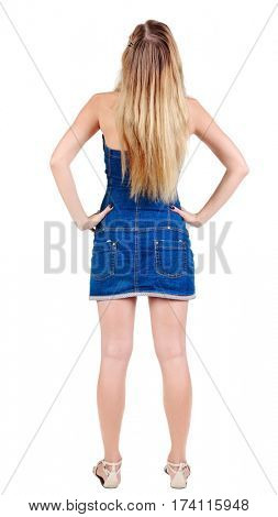 Back view of beautiful yong woman  looks ahead. rear view. Isolated over white .