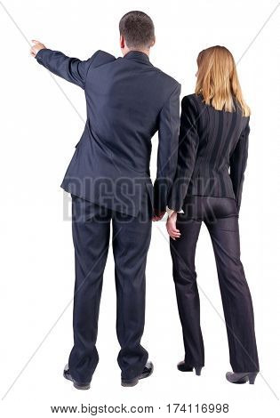 Back view of  pointing business team. young couple (man and woman) . beautiful friendly girl and guy in suit together. Rear view people collection. backside view person. Isolated over white background