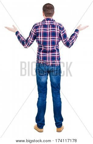 Back view of angry young man in jeans and checkered shirt. Rear view. isolated over white. backside view of person.  Rear view people collection. Isolated over white background.