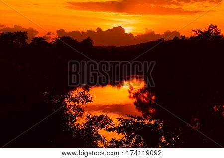 sunset beautiful colorful landscape and silhouette tree water reflexion in sky twilight time