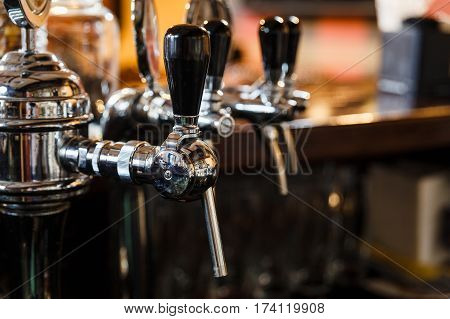 Close-up of the beer pipes on bar counter