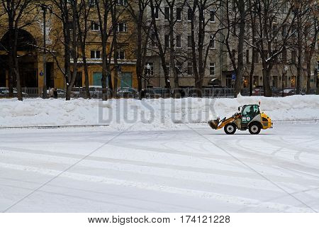Moscow Russia - February 14 2017: Snowblower removes snow from the rink at Patriarch's ponds in Moscow