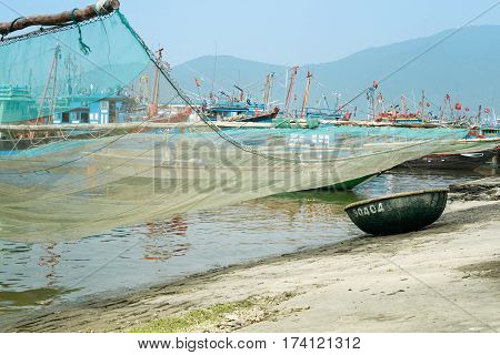 Traditional Fishing Boat with Net and Woven Bamboo Basket Boat At The Fishing Village in Da Nang, South Vietnam