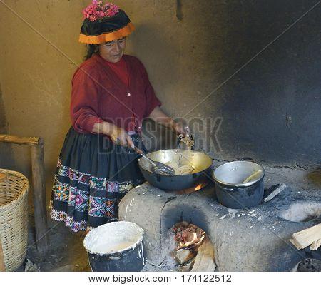 Native Peruvian woman preparing Cachangas aka fried bread on a primitive stone oven. October 22 2012 - Paru Paru Peru