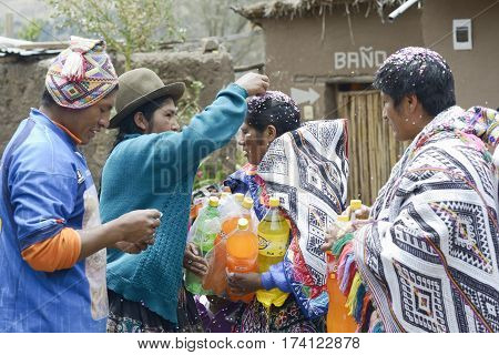 Traditional Quechua Wedding Ceremony. Indigenous woman putting confetti in the bride`s mother hair. October 22 2012 Paru Paru Peru