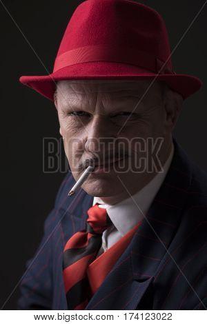 Portrait of a mature Jazz man smoking a cigarette