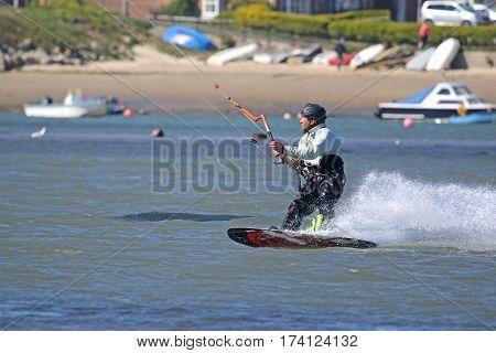 kitesurfer riding his board in Portland harbour