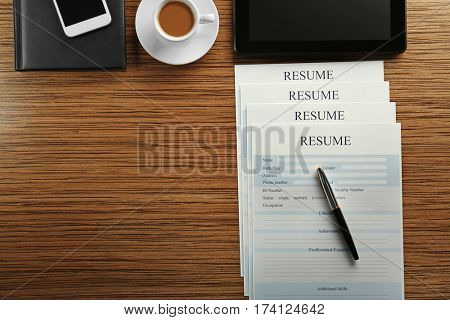 Employer workplace with resumes