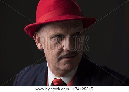 Portrait of a mature Jazz man on a black background.