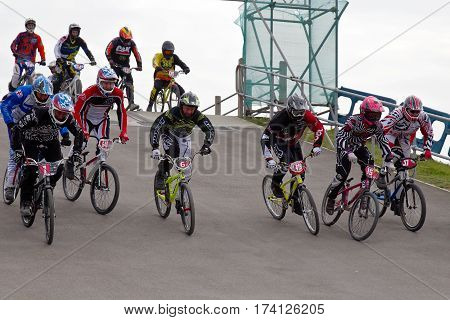 GRAVESEND, UK - APRIL 12: Riders competing in the mens class of the UK National BMX championships at the Kent cyclopark head down the start ramp at speed on April 12, 2014 in Gravesend