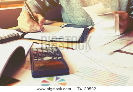 Man And Writing Make Note And Calculate About Cost .