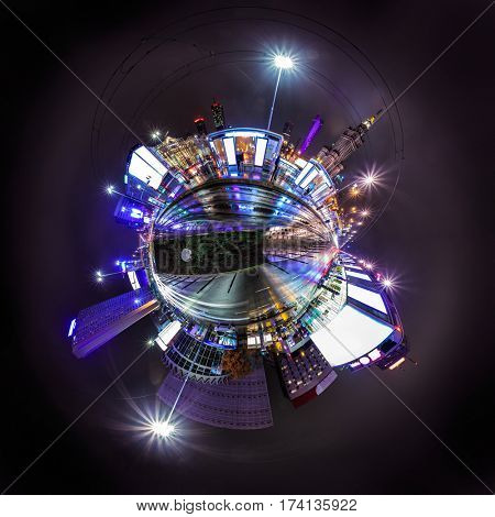 Night skyline of Warsaw with soviet era Palace of Culture and science. 360 degree panoramic montage as tiny planet