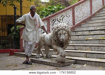 KOLKATA, INDIA - FEBRUARY 09: Guardian and a statue of a lion at the entrance to the Sree Sree Chanua Probhu Temple in Kolkata, West Bengal, India on February 09, 2016.
