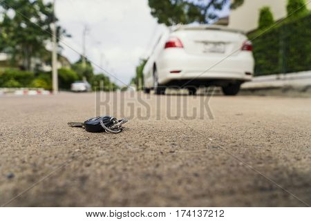 abstract car key fall on the cement ground - can use to display or montage on product