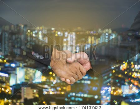 abstract businessman shakehand for commit on bokeh cityscape background - can use to display or montage on product