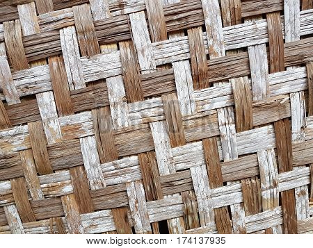 pattern of old Thai house wall for background and texture. Made of bamboo plant stalks.