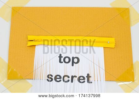 Top Secret destroying sheet of paper with yellow zipper as a shredder.