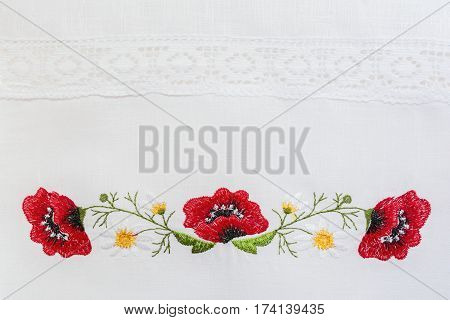Embroidered Floral Pattern On A White Linen Towel