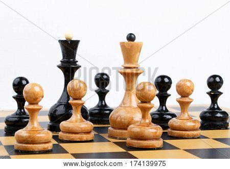 The chess pieces placed on the chessboard. White background