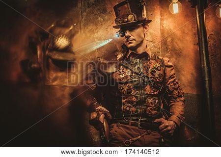 steampunk style man with various mechanical devices on vintage steampunk background
