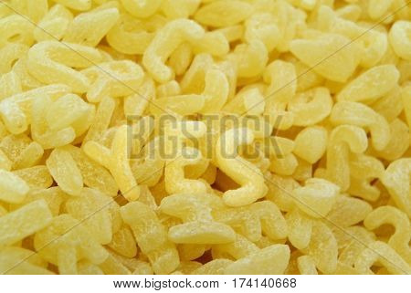 Close up yellow background of delicious pasta in the form of letters forming word yes