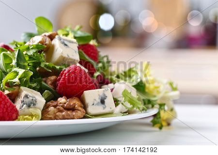 Green Spring Salad With Blue Cheese , Raspberry And Nuts