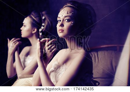Stylish woman with creative make-up of pearls