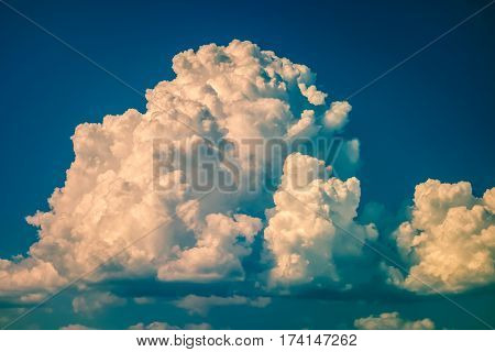 a big and fluffy cumulonimbus cloud in the blue sky