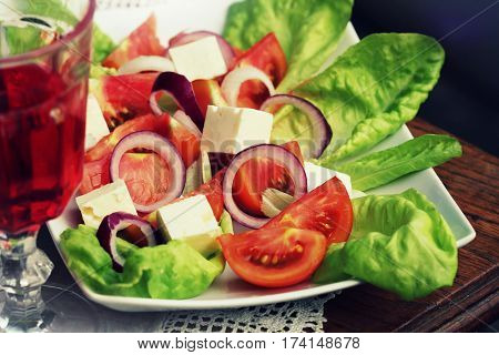 salad with lettuce, goat cheese and tomato outdoor