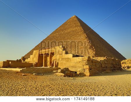 The entrance of the mastaba of Seshemnufer IV and the Great Pyramid in background. Giza, Cairo, Egypt