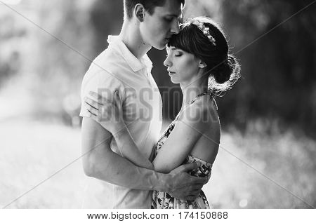 Black and white art romantic photography monochrome loving couple in the birch forest. Man and woman walking on nature romantic. Hugging each other. Be happy. Romantic couple