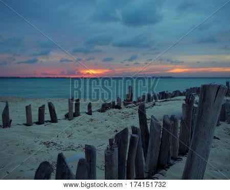 A makeshift jetty at sunset on Isla Mujeres, Mexico's Playa Norte Beach