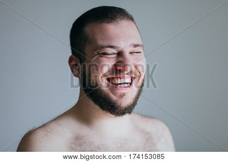 Portrait of young man laughing out loud