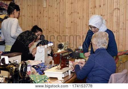 MellanselSweden - Februari 022017:Refugees and Retired women together with handwork as a part of integration to the Swedish society.