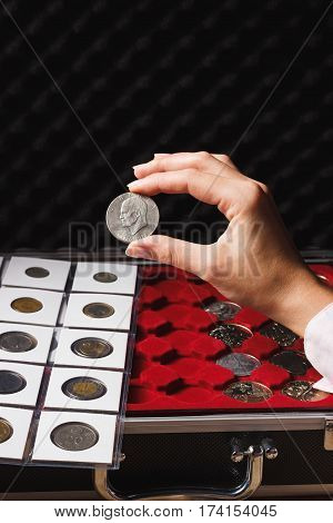 Dollar Coin In The Woman's Hand