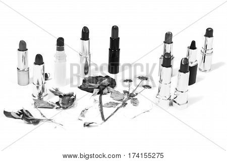 Black and white art photography monochrome ipstick isolated on white background. Female lip pencil. Kiss of lips on paper. The word love written in lipstick. View from above. Concept. Decorative cosmetics