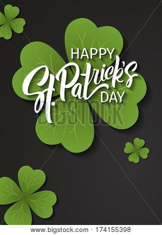 Happy St. Patrick's Day greeting. Lettering St. Patrick's Day on a dark background with shamrock.