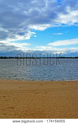 Samara, city beach on the shores of the Volga River at cloudy autumn day, beautiful cumulus clouds