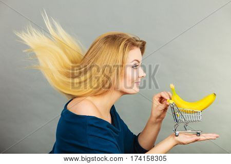 Woman Holding Shopping Cart With Banana Inside