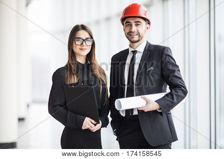 An attractive man and woman business team working construction on the building site