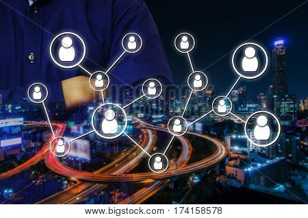 double exposure of man crossing arms and social media network connection concept on night city background, color tone effect.