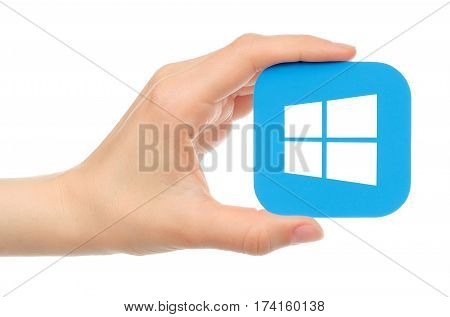 Kiev Ukraine - May 17 2016: Hand holds Microsoft Windows icon printed on paper