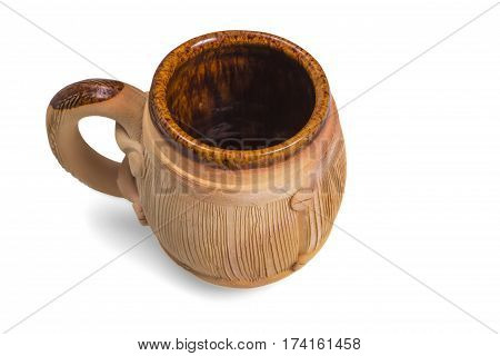 Decorative ceramic mug on a white background with shadow.