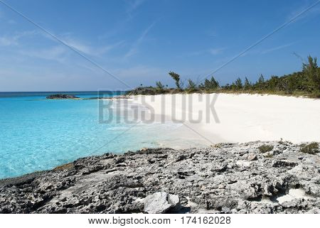 The view of an empty beach on uninhabited island Half Moon Cay (The Bahamas).
