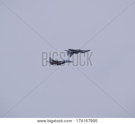 Krasnodar Russia - February 23 2017: Air show in the sky above the Krasnodar airport flight school. Airshow in honor of Defender of the Fatherland. su-35 in the sky.