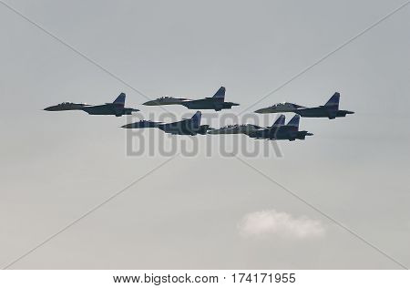 Nizhniy Tagil Russia - July 12 2008: Group of airfighters SU-27 displays of fighting opportunities of equipment with application of aviation means of defeat. Russia Arms Expo exhibition