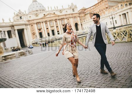 Loving young couple in the Vatican Italy