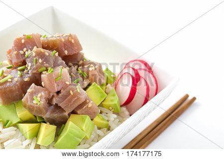 Hawaiian tuna poke bowl with avocado, radishes and sesame seeds, isolated on white background